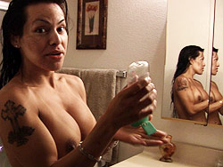 At home with foxxy. Hot tranny Foxxy oiling herself